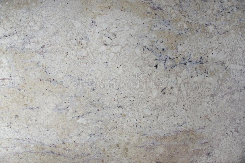 Background natural light beige stone with dark speckles called granite Bianco Romano stock photo