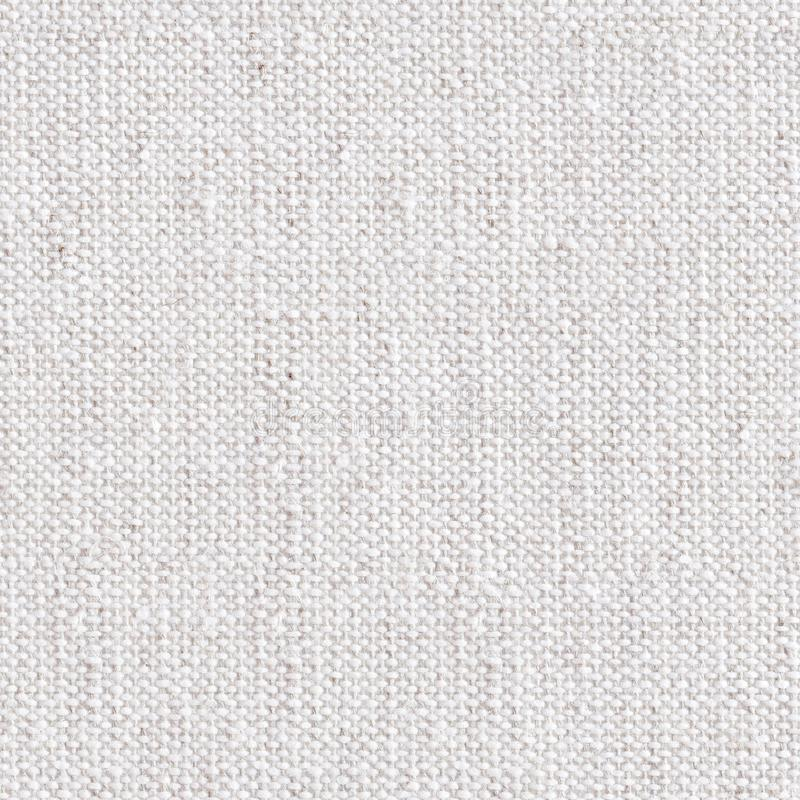 Background of natural linen fabric. Seamless square texture. Tile ready. royalty free stock photos