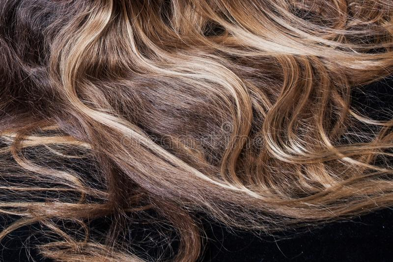 Background from natural long blonde woman hair. Studio shot closeup stock photography