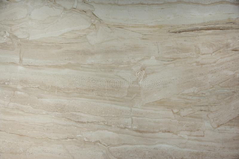 Background of natural stone marble beige color with a beautiful pattern, called Bressia Sarda royalty free stock image