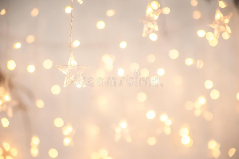 Background of New Year`s garlands like stars. Christmas atmosphere with garlands in focus and defocus.  stock photography