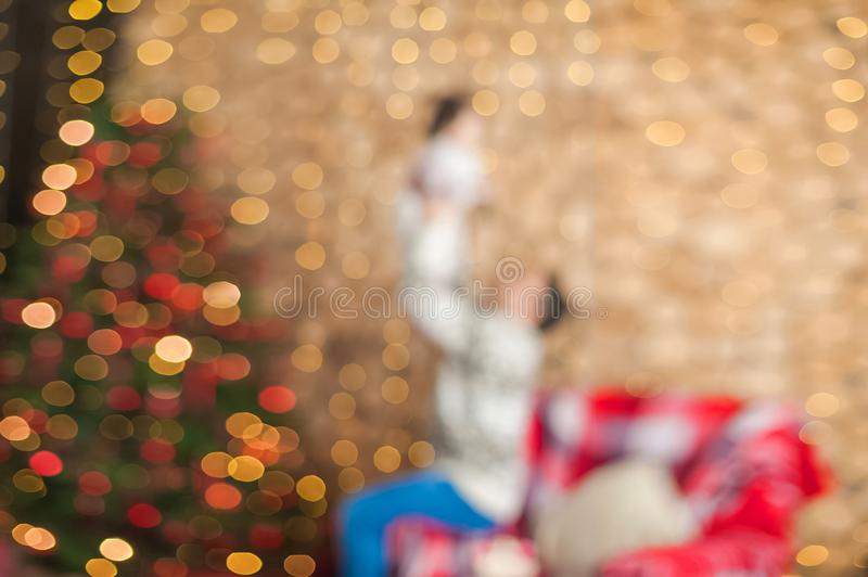 Background of New Year`s garlands like stars. Christmas atmosphere with garlands in focus and defocus. Father with a child plays i stock photos