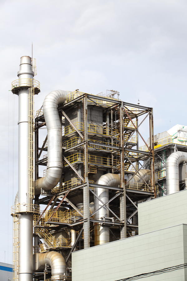 Oil Refinery factory. Background with Oil Refinery factory and sky stock image