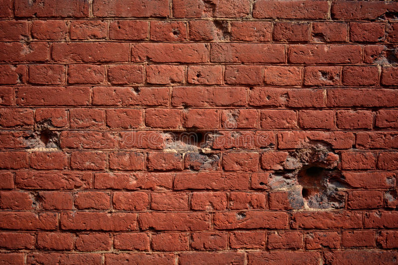 Background old brick wall with holes of bullets stock images
