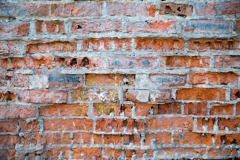 The background of an old brick wall is partly ruined by masonry. stock image