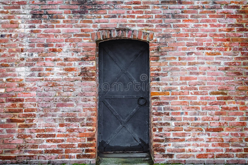 Background old brick wall and wrought iron door stock photos