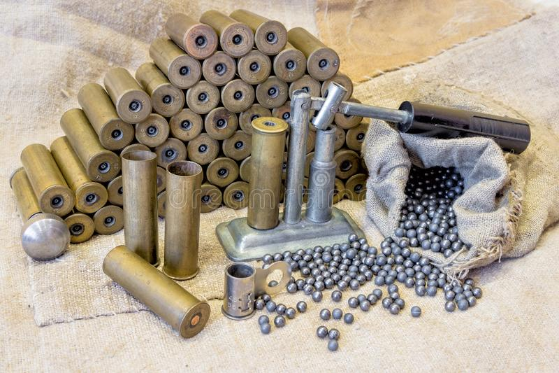 Background on the old burlap lie brass metal shell casings with stock photo