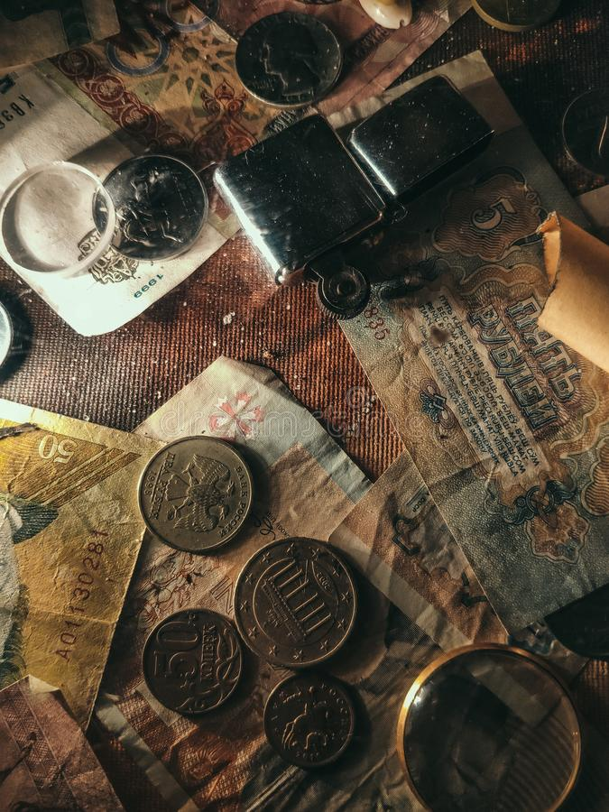 Background of old coins. Paper with a pattern studded with old coins. royalty free stock photography