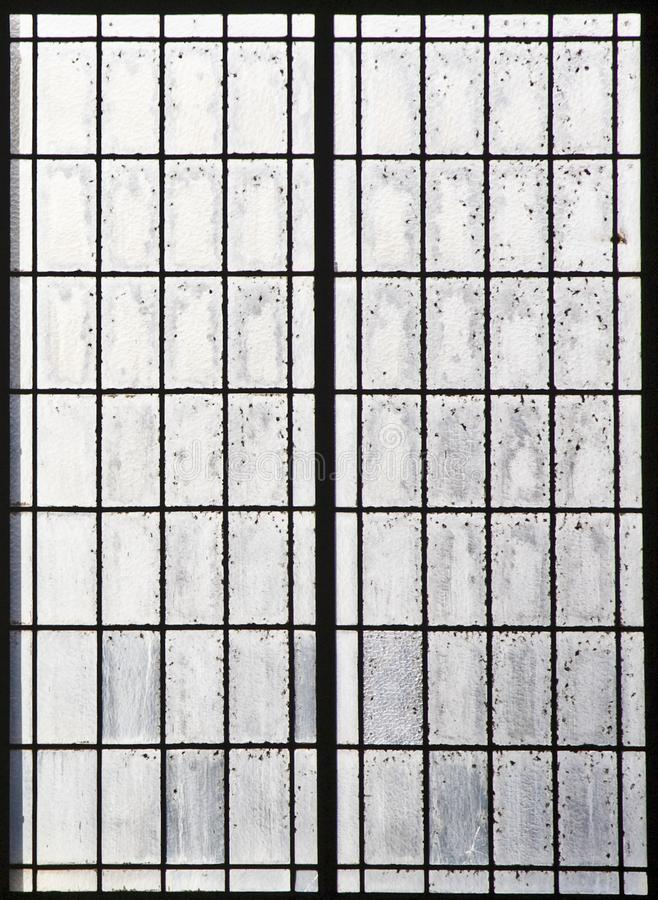 Background of old industrial window with dirty glass in rectangle structure royalty free stock photos