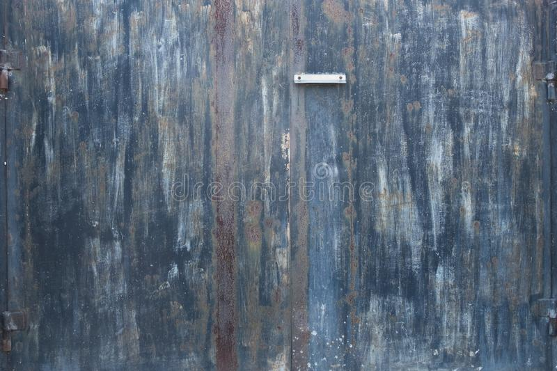 Background of old iron rusty gate. Gates with peeling paint. Black gate with a slot for mail. The texture of the old metal fence. royalty free stock photography