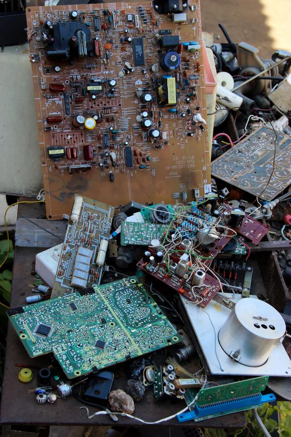 Background with old rare electronic components randomly decomposed stock photo