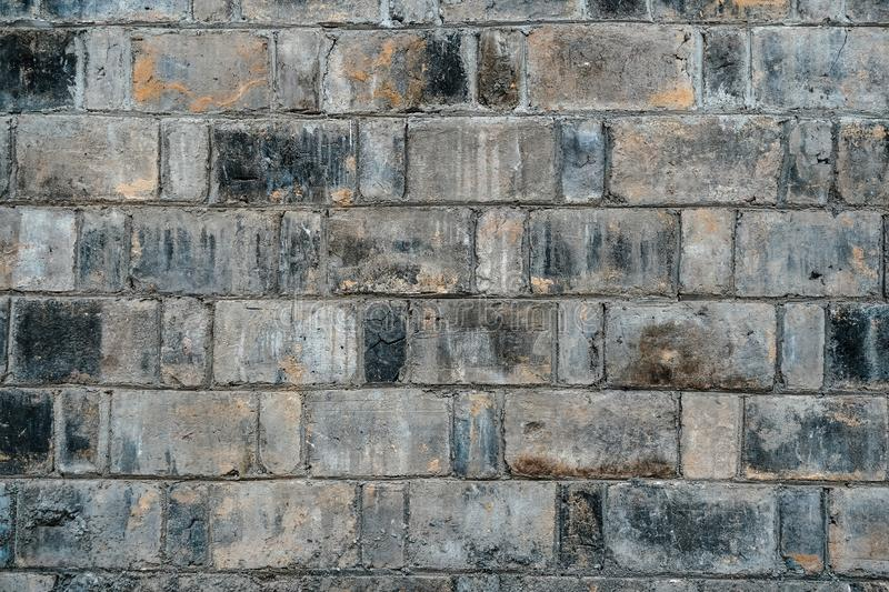 Background of old vintage black and gray dirty brick wall texture stock images