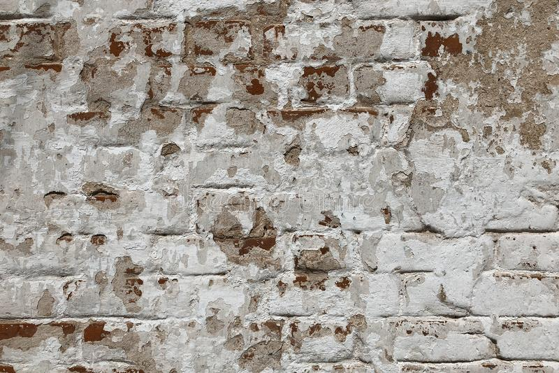 Background of old vintage dirty brick wall with peeling plaster, texture royalty free stock photos