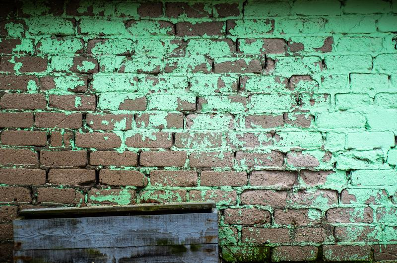 Background of old vintage dirty brick wall with peeling plaster, texture stock photography
