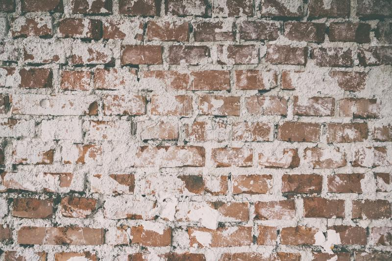Background of old vintage dirty brick wall with plaster, Brick wall background texture with faded effect, Painted distressed wall royalty free stock photo