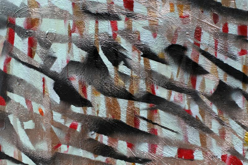 Background of old wall with unpainted colored lines. Stencil with masking tape. Red black and blue layers stock photography