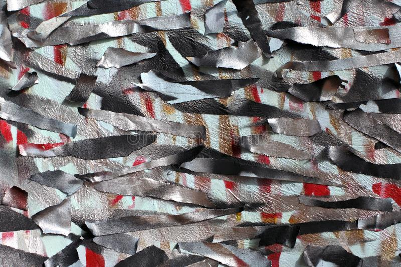 Background of old wall with unpainted colored lines. Stencil with masking tape. Red black and blue layers stock photo