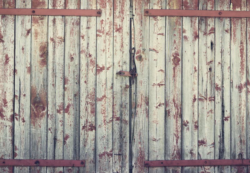 Background old wooden barn door. Toning royalty free stock photos