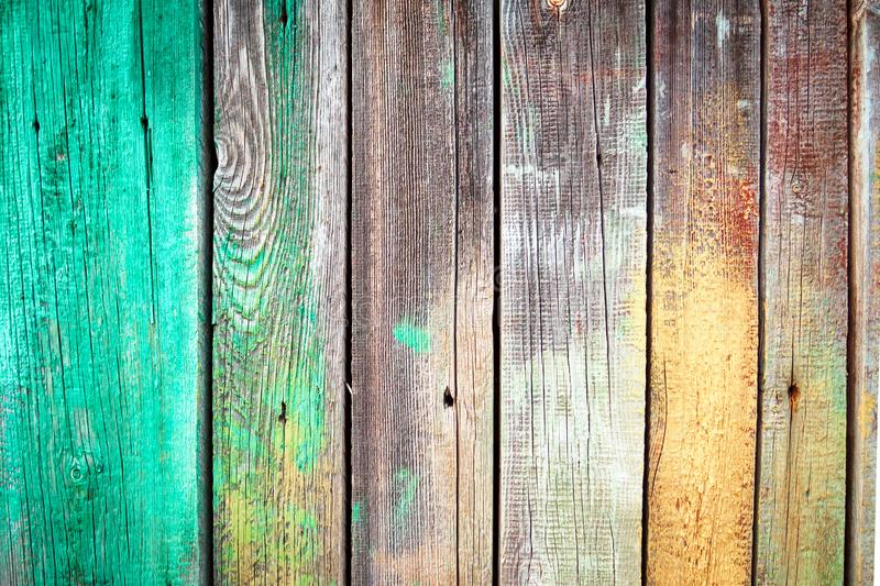 Background of old wooden boards with nails, green and yellow paint stains on textured wood plank. stock images