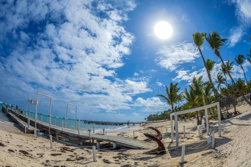 Background with old wooden dock and beach in Punta Cana, Dominican Republic stock photography