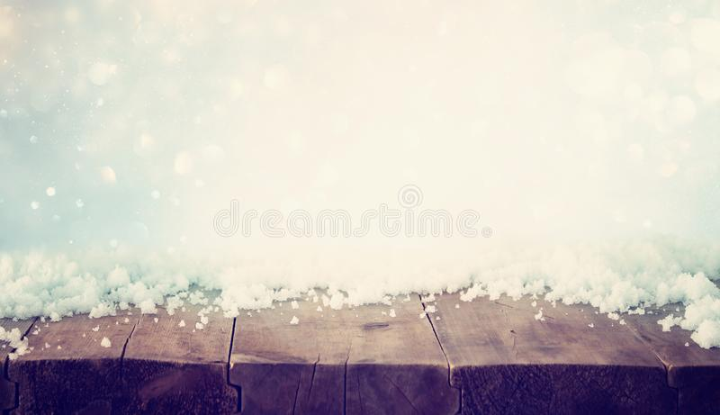 background of old wooden table wuth snow. Ready for product display montage stock photos