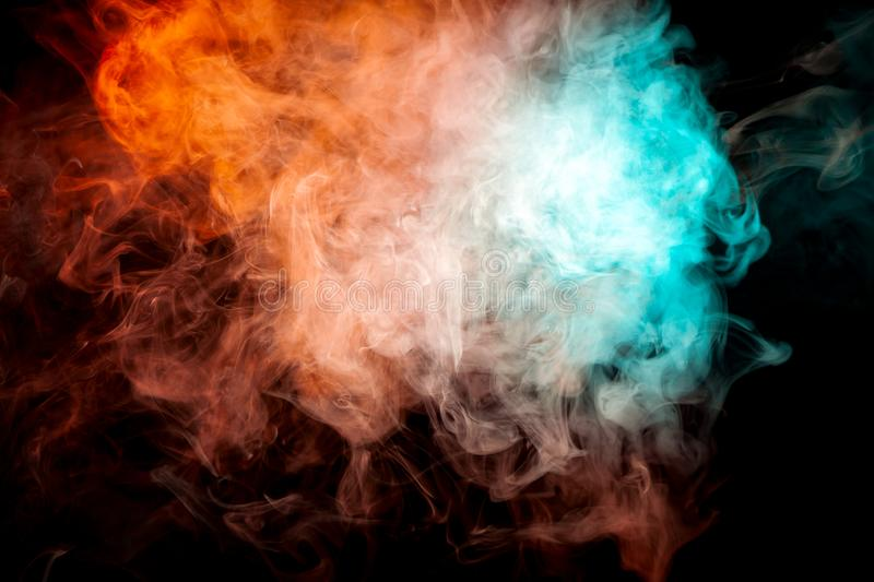 Background of orange, white and blue wavy smoke on a black isolated ground. Abstract pattern of steam from vape. stock photos