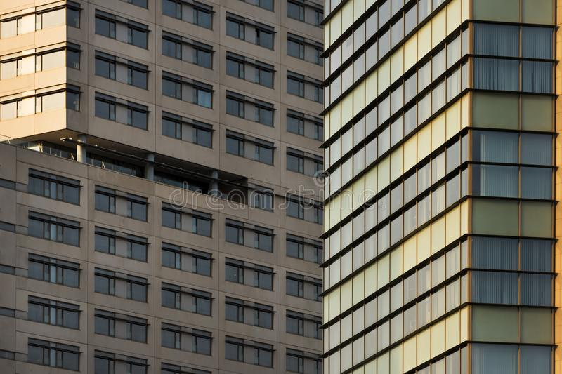 Background of overlay concrete facades. Horizontal composition with a close-up of facades of concrete buildings, which have dull colors, to use as background royalty free stock image