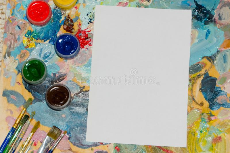 Clipart, white sheet of paper with brushes background royalty free stock images