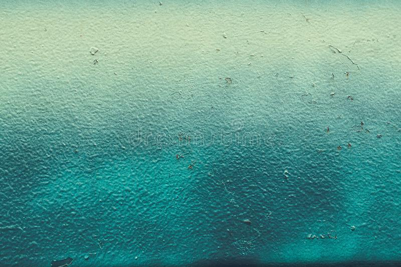 Background of a painted green and blue iron metal sheet. Rusty iron metal texture surface. Background for web design and royalty free stock photo