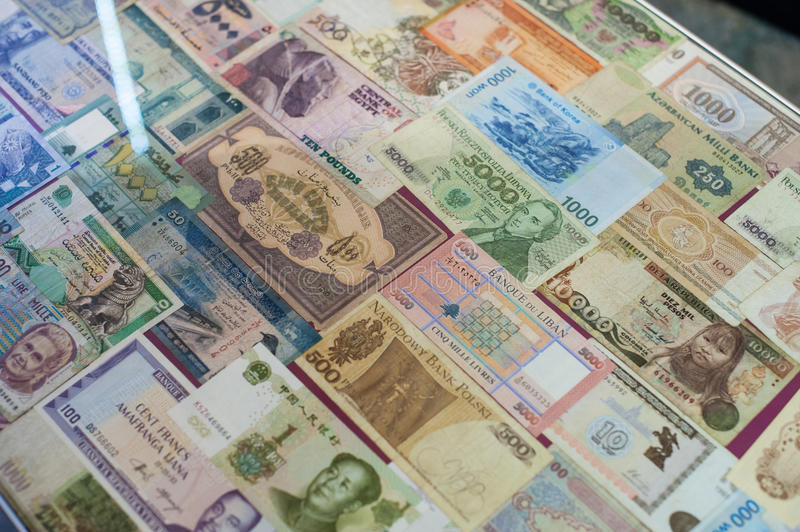 Background from paper money of the different countries.  royalty free stock photo