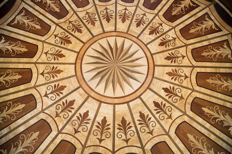 Background of the parquet of different breeds of a tree drawing circles lilies rays from the center. Backgrounds Structure. Design royalty free stock images