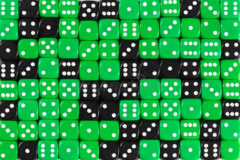 Background patteren of random ordered green and black dices. Pattern background with two-third random ordered green dices and one-third black dices royalty free stock images