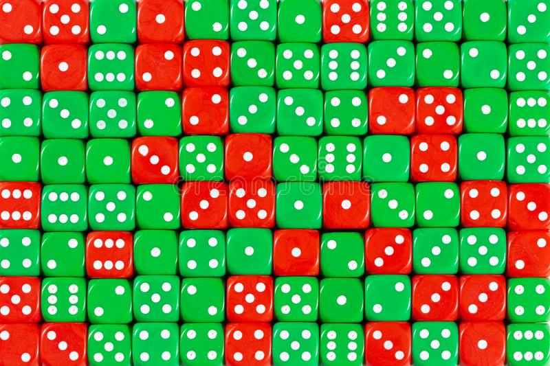 Background patteren of random ordered green and red dices. Pattern background with two-third random ordered green dices and one-third red dices stock photos