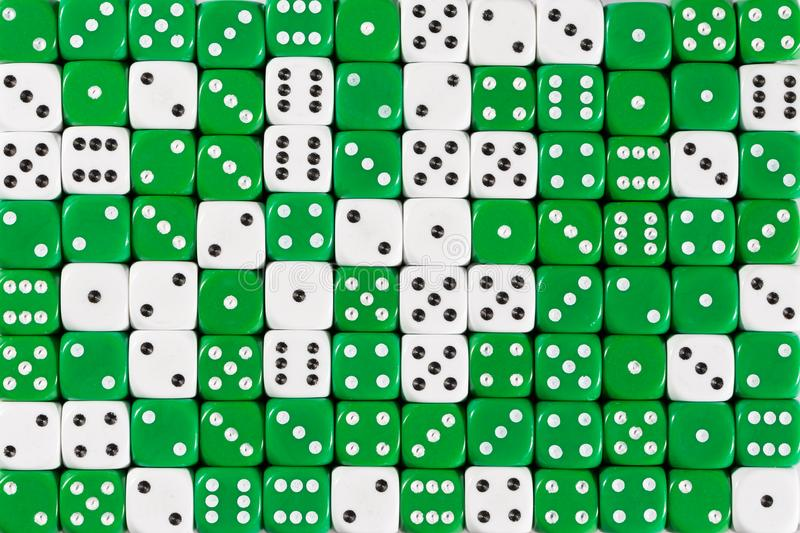 Background patteren of random ordered green and white dices. Pattern background with two-third random ordered green dices and one-third white dices royalty free stock photography