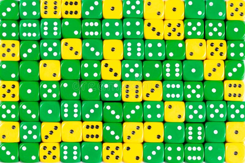Background patteren of random ordered green and yellow dices. Pattern background with two-third random ordered green dices and one-third yellow dices royalty free stock image