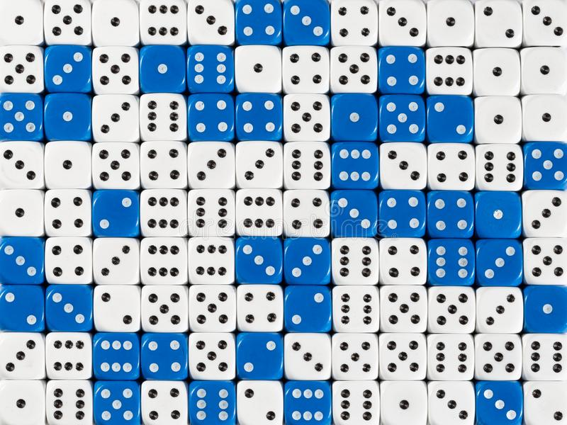 Background patteren of random ordered white and blue dices. Pattern background with two-third random ordered white dices and one-third blue dices royalty free stock photos
