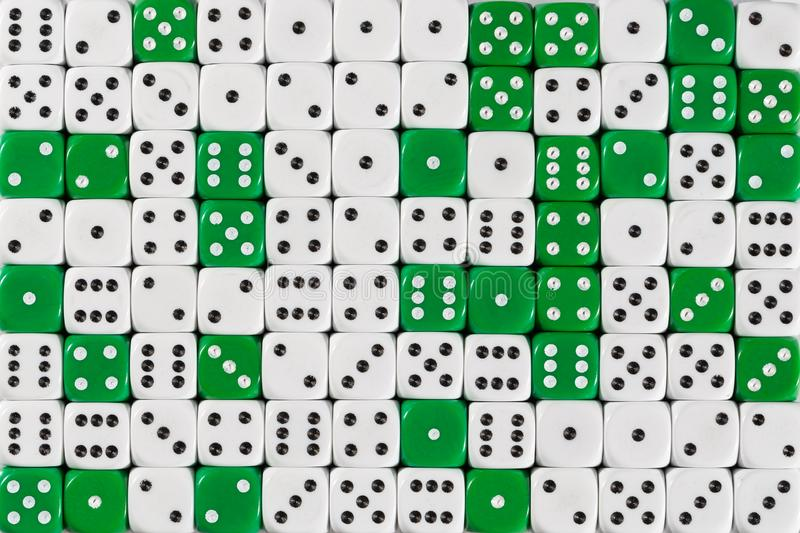 Background patteren of random ordered white and green dices. Pattern background with two-third random ordered white dices and one-third green dices stock photo