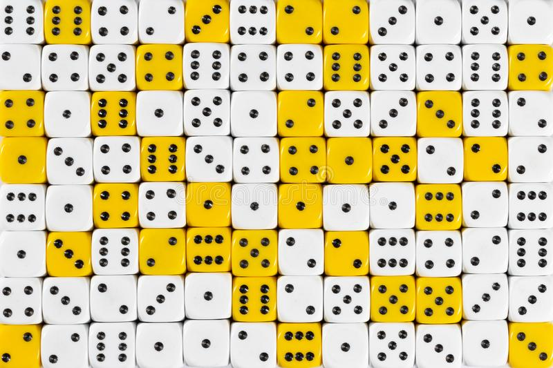 Background patteren of random ordered white and yellow dices. Pattern background with two-third random ordered white dices and one-third yellow dices stock photo