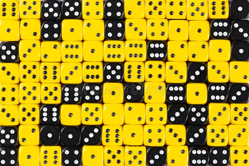 Background patteren of random ordered yellow and black dices. Pattern background with two-third random ordered yellow dices and one-third black dices stock photography