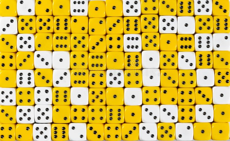 Background patteren of random ordered yellow and white dices. Pattern background with two-third random ordered yellow dices and one-third white dices stock image