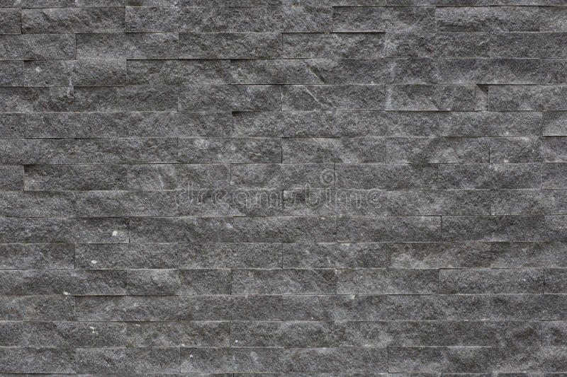 Background pattern of decorative slate stone wall surface. High quality stock image