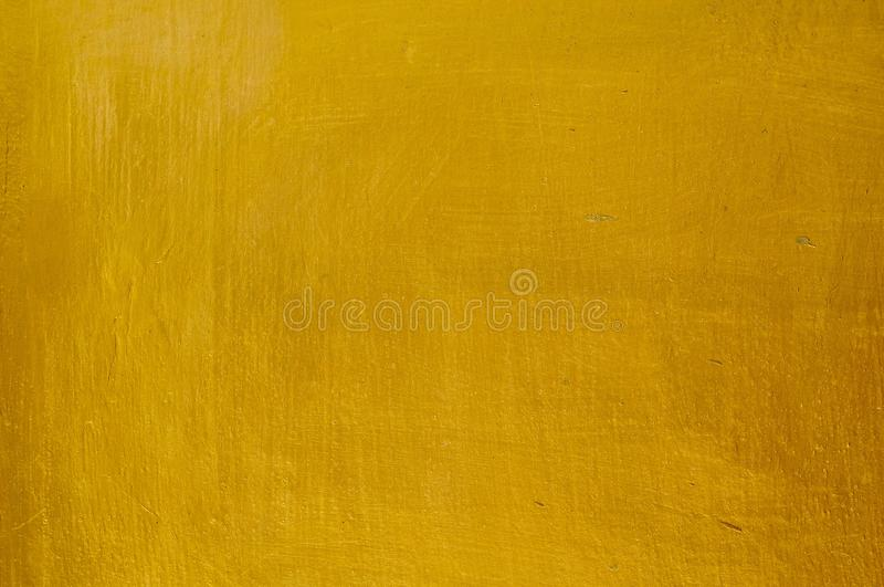 Horizontal Texture of Gold Stucco Wall Background stock image