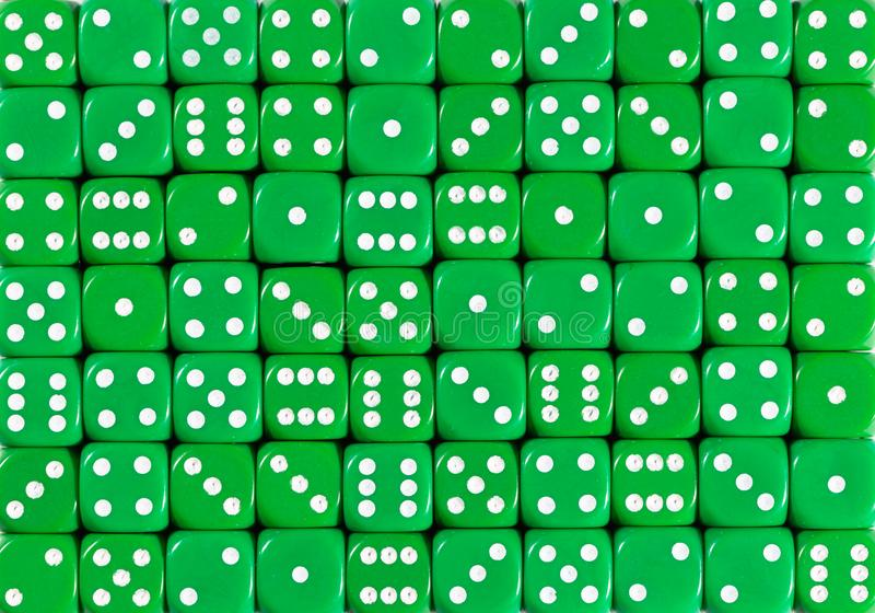 Background pattern of 70 green dices, random ordered royalty free stock photos