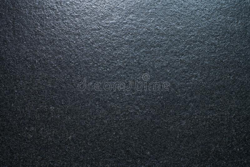 Background pattern natural dusty black slate texture. With natural light on top stock photo