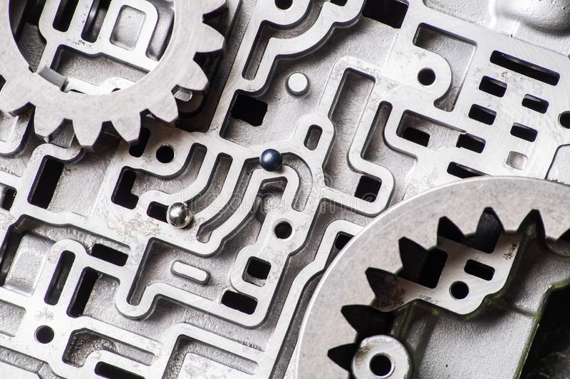 Background and pattern of old metal parts of the gearshift box. Hydro-brain transmissions and gears. stock image