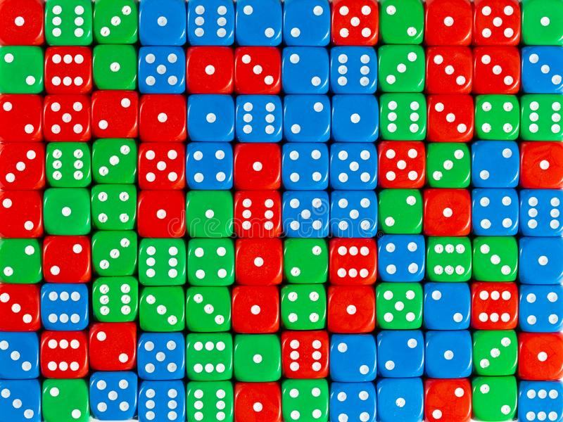 Background pattern of random ordered red, green and blue dices. Pattern background of random ordered red, green and blue dices stock photography