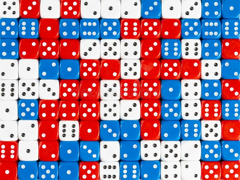 Background pattern of random ordered red, white and blue dices. Pattern background of random ordered red, white and blue dices stock photos