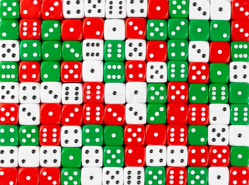Background pattern of random ordered white, red and green dices. Pattern background of random ordered white, red and green dices stock photos