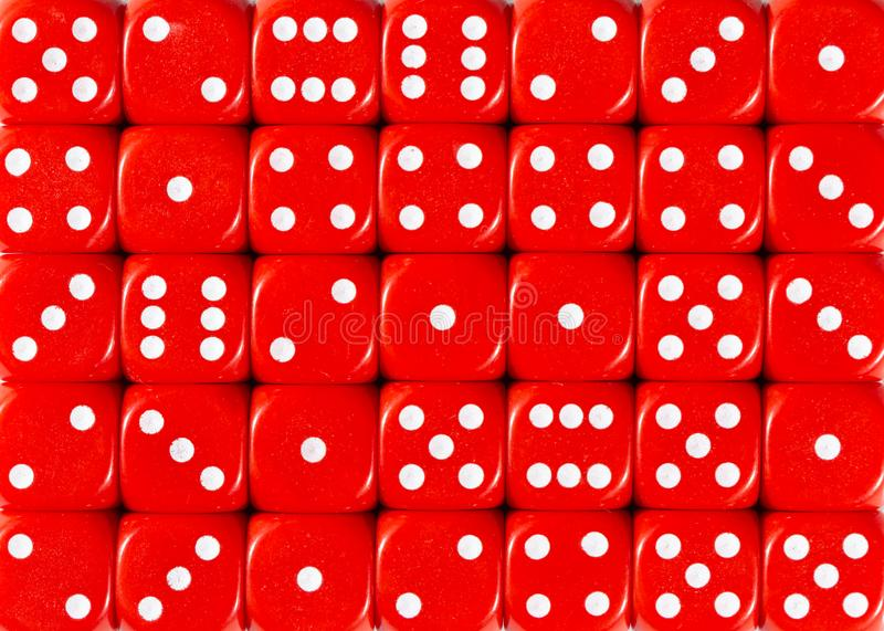 Background pattern of red dices, random ordered royalty free stock images