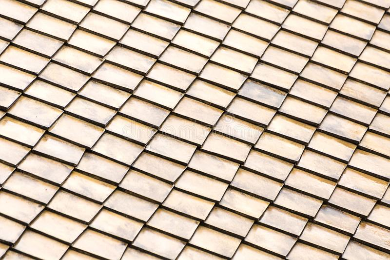Background pattern roof light tile light beige gray, set of wooden rectangles dice endless. Base stock photo